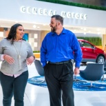 Employees have a walking meeting in GM World at the GM HQ Renaissance Center in Detroit, Mich.