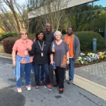 Associates show off their orange shoe laces in celebration of National Walking Day
