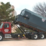 Community Waste Disposal photo: CWD Roll Off compactor services.