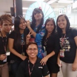 Picture taking with my co-workers and with our team leader dressed up like a Japanese girl.