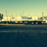 United Site Services photo: 3 axle, ten speed International tractor and 5,000 gallon tanker trailer.