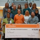 OMX Associates raised money through their wellness activities to donate $10,000 to the Foundation
