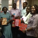 photo of Barclays, 2013 Barclays Plaza exchanging departmental Santa gifts