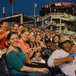 Interns and their managers enjoy a baseball game.