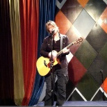 Johnny Rzeznik performaing at the NY staff meeting