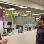 Employees at our Boston office trying out the VR rig developed by Wayfair Next.
