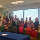 Building backpacks in our Clearfield location for kids to their first day of school.