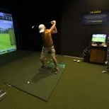 A customer perfects his swing in one of our hitting bays.