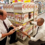 Ingles Markets photo: Two supervisors helping each other
