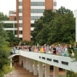 Some students walking across Library Bridge