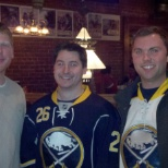 A group of UAC employees enjoying a hockey teambulding event.