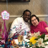 Atria Rosyln Harbor staff member joins a resident for her birthday celebration.