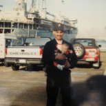 Me and my little boy meeting for first time after deployment to Middle East, Desert Shield.