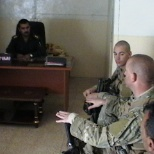Conducting meetings with local military and police leadership