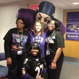 "The Sinai Hospital Department of Surgery poses with a ""Ravens"" player to celebrate the Super Bowl."