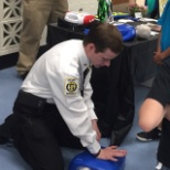 Giving back: Teaching CPR to students.