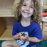 Hands-on experiences during summer camp ... holding a real star fish!  Amazing!