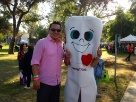 Mighty Molar with a Gentle Dental team member at the Mariachi Fest 2013.
