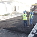 Laying of asphalt base course layer