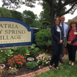 Staff gather outside of Atria Bay Spring Village before their Grand Opening celebration.