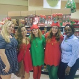 Associates dressed up as elves for Mr and Mrs Clause.