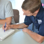 RTB Academic Coaching photo: An Academic Coach working with a student on some Calculus homework.