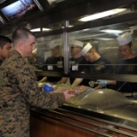 Nimitz CPO's serving dinner to the crew.