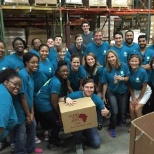 Cortland Partners photo: Partnering with Books for Africa during Cortland Commitment 2015