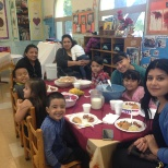 Family staff and children spend time together at our annual Fall Feast