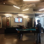 Employees enjoy a game of pool or ping pong
