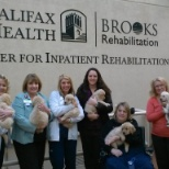 Patients / Staff in the Center for Inpatient Rehabilitation receiving some extra special puppy love.