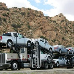 Pasha Distribution Services hauling new cars to Car Dealers