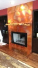 Flamed copper fireplace surround.