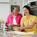 Comfort Keepers photo: Helping with meal preparation.