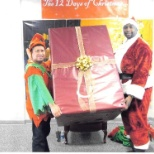 Francisco the helpful Elf with Santa Claus