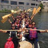 Employees participating in a Dragon Boat Race!