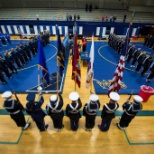 Wrestling teams from all 4 branches stand at attention before the 2016 armed forces wrestling tourny