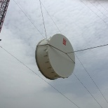 New Age Technologies photo: Raising a 2.4m antenna to be installed on the tower at 65m hieght,