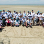 Our employees in Malaysia spruce up local beaches by removing trash and other debris from the beach.