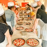 Our Marketing learned to make pizza at a recent meeting!