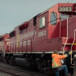 A Conductor climbs a locomotive.