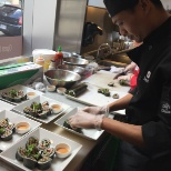 A Sushi Champ participant plating his entry.