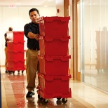 JK Moving Services photo: Commercial team members conduct professional office moves with reusable, sustainable crates.