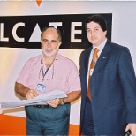Alcatel Lucent photo: receiving prize from regional Manager
