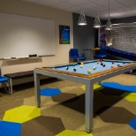 Unwind after a long day of work in one of our game rooms.