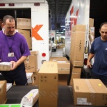 FedEx photo: Loading Packages into trucks and scanning them