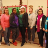 Staff volunteering at the holiday toy give away