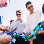 Employees join together to cut the ribbon at the VMware campus opening ceremony.