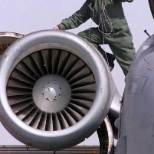 Installing vibration analysis equipment on an A-10 engine.