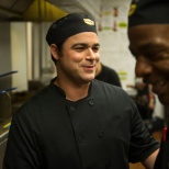 One of our Cooks sharing a laugh with his team.